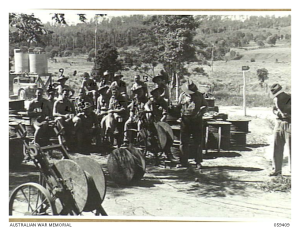"""BARRINE, QLD. 1943-10-30. DETACHMENT OF THE 2/2ND AUSTRALIAN LINE SECTION AND THE 2/1ST AUSTRALIAN MAINTENANCE SECTION, """"A"""" AUSTRALIAN CORPS OF SIGNALS HAVE A SPELL WHILE RECONDITIONING FIELD CABLE ON DRUMS. THEY ARE:- TX1224 LANCE CORPORAL (L CPL) A. G. BOATWRIGHT (1); QX7920 SIGNALMAN (SIG) T.W. HORBURN (2); VX30070 L CPL C. LONG, (3); VX9973 SERGEANT C.T. DORGAN (4); QX13323 SIG F.H. NUGENT (5); NX30664 CORPORAL (CPL) W.N. MITCHELL (6); VX13834 SIG J.W. COBBY (7); VX10511 SIG L. FARMER (8); NX29851 SIG J.H. WILLIAMS (9); QX4499 SIG R.H. BAMBRICK (10); NX91000 SIG H.R. COX (11); NX30047 SIG M.R. CHICK, (12); QX8087 SIG A.J. HOEY (13); NX17194 CPL N.F. PIPER (14); NX58913 SIG A. CARROLL (15); NX55488 SIG A.W. BUCHANON (16); SX10821 SIG J. COX (17)."""