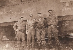 "L to R: Pfc Charles ""Toughy"" Sobrito (brakeman/flagman), Sgt. Jim F. Deaton (conductor), T/4 Frank Hacker (engineer), and T/5 F.C. ""Fudge"" Moschini (fireman). This picture was taken in the spring of 1945 in Warburg, Germany."