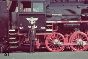 "The newly delivered Reichsbahn train with factory number ""50 467"" in Thorn (East Prussia.) The Reichsbahner (railway worker) at the front of the camera wearing a special uniform for the occupied territories with 8 buttons (usually 6), and the rare and only briefly used Litzenkragenspiegel of Generalgouvernement Polen. Unfortunately, the photographer had no steady hand and it has bit blurred when shooting. Also noteworthy is the Reichsbahn Adler, in which here the two letters ""D"" and ""R"" are attached on both sides of the emblem, which was more typically used in cars. The picture was taken by Walter Hollnagel in June 1940"